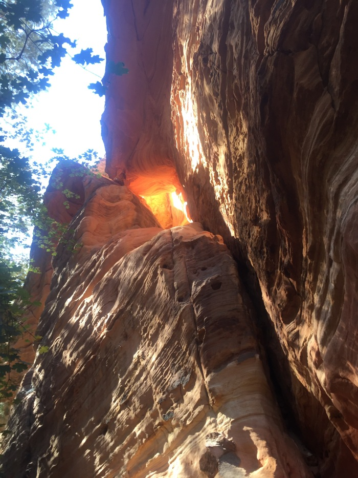 The sun looked like fire coming through the rock.